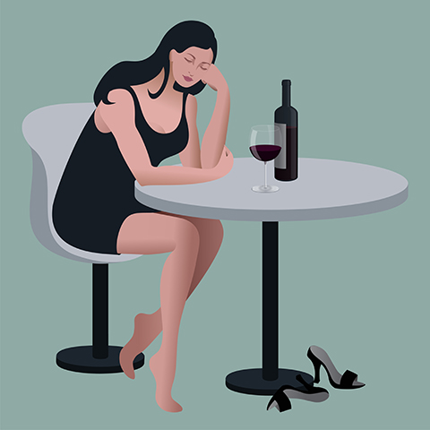 Lonely depressed woman with wine