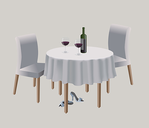 White tablecloth, white chairs, wine bottle and two glasses of red wine on the table