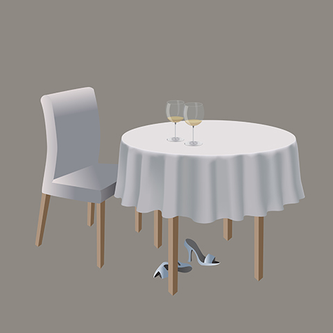 White tablecloth, two glasses of white wine on the table